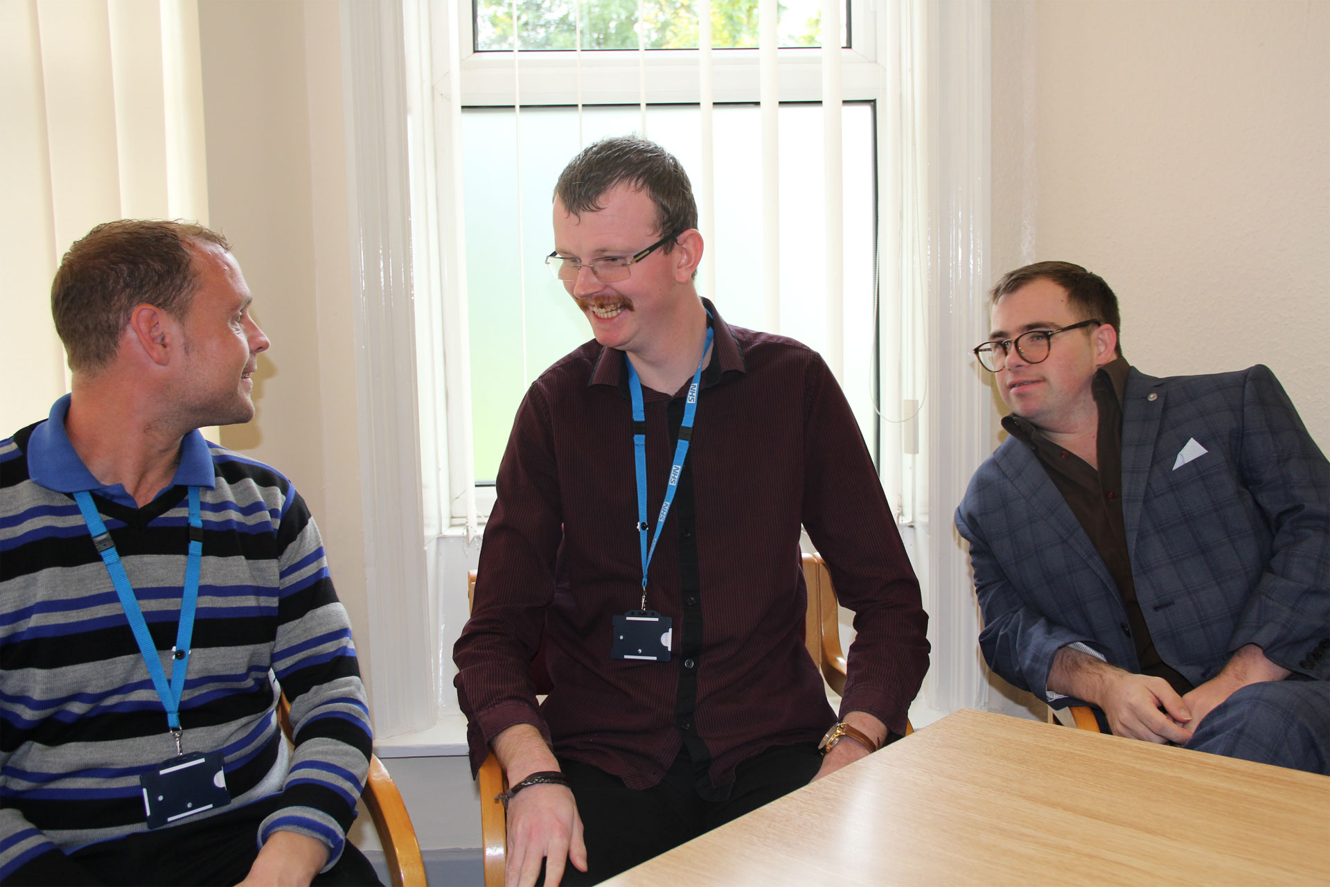 three-learning-disabilities-colleagues-sitting-talking-smiling.JPG